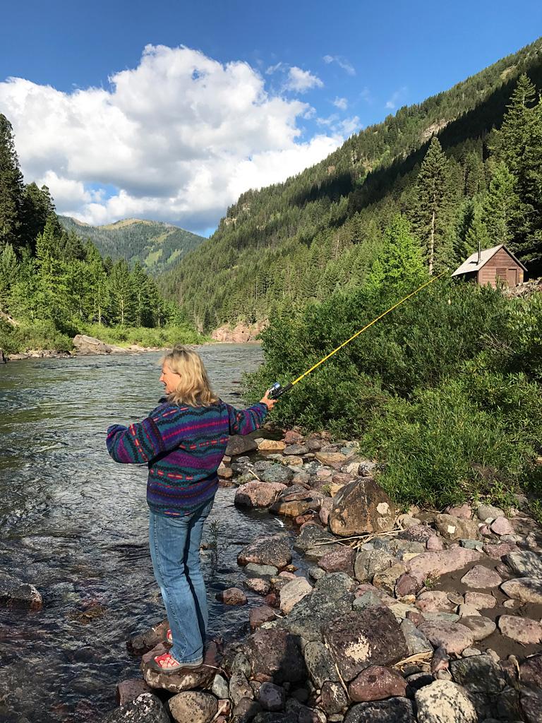 Photo of Gini Ogle fishing.