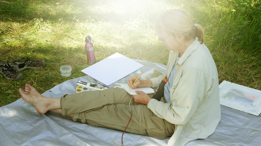 Photo of Francesca journaling.