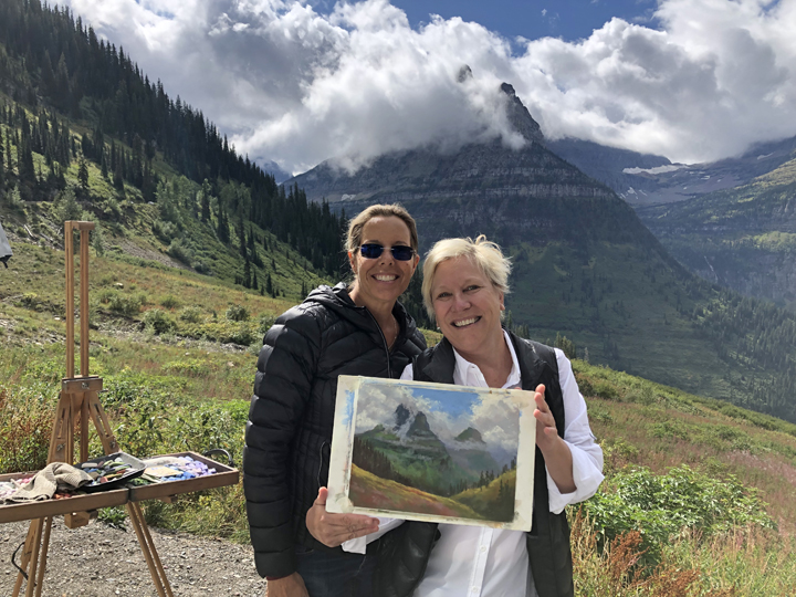 Photo of two women holding my painting.