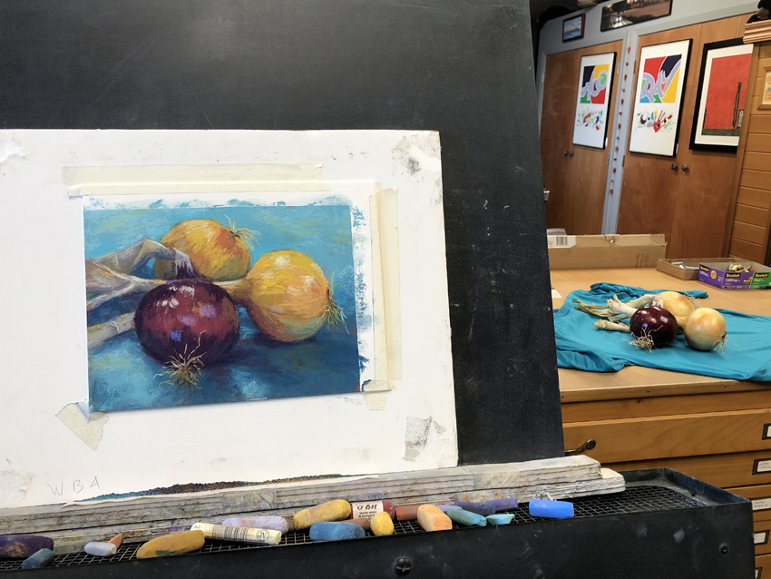 Photo of painting setup of onions.