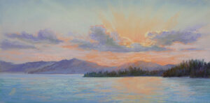 Photo of pastel painting of a sunset on Flathead Lake.