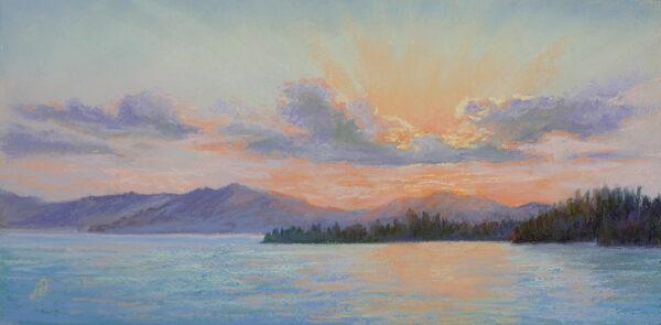 Photo of pastel painting of a sunset on Flathead Lake.