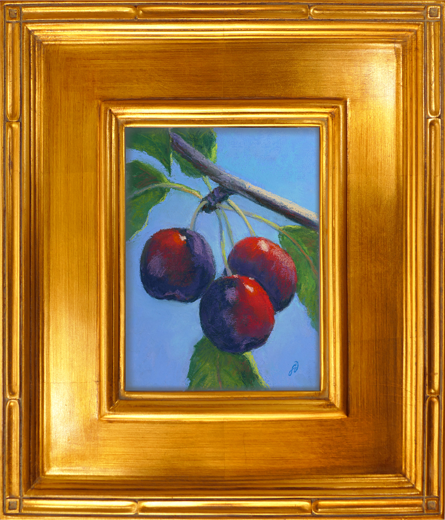 Pastel painting of cherries in gold frame