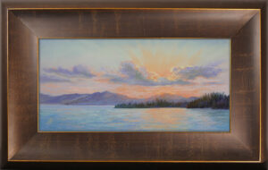 Photo of a framed pastel painting of Flathead Lake.