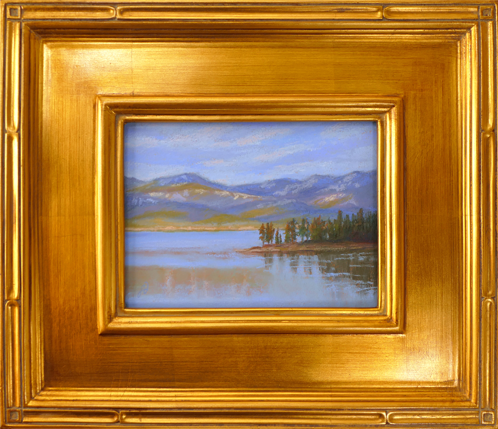 Pastel painting of Flathead Lake and Yenne Point with gold frame.