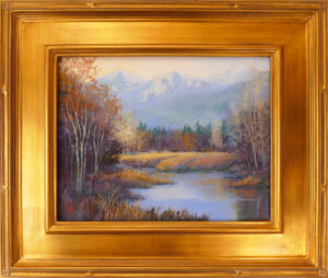 Pastel painting of the north shore of Flathead Lake with the autumn golds and oranges framed in a gold leaf frame.