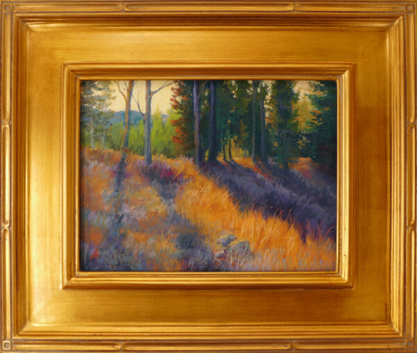 Pastel painting of Crane Mountain with sunlight streaming through the trees framed in gold leaf.