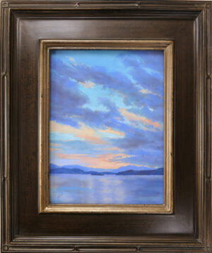 Pastel painting of a sunset over Big Arm on Flathead Lake, Montana, in a frame.