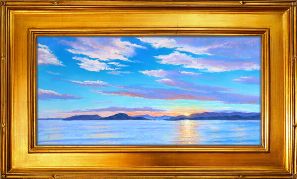 Photo of a painting of a Flathead Lake sunset with frame.